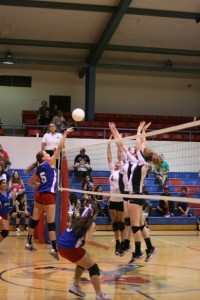 #5 Analisa Robles tips the ball over Amphi blockers