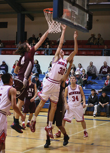 #4 Erik Goodwin blocks the shot in a win for the Bearcats..JPG