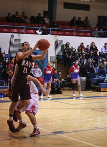 #21 Quentin Camacho looks for  the open shot against San Manuel..JPG