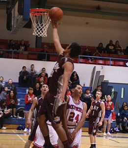 # 3 Brandon Acevedo lays it up over the Miners ..JPG