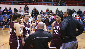 Head Coach Aaron Chenoweth gathers the Lady Cats for some instruction.JPG