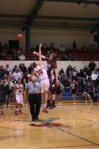 #30 Andy Monfred gets the jump ball against the Bearcats.JPG