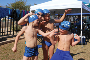 Mason Stewart, Riley Stewart, Evan Apuron, and Ethan Kellam get ready to race in a relay.JPG