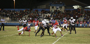 Miners running back #32 Ben Quijada fights off a Canyon State defender.JPG