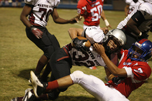 San Manuels #7 Bryan Valdez brings down the ball carrier for the Canyon State Rams.JPG
