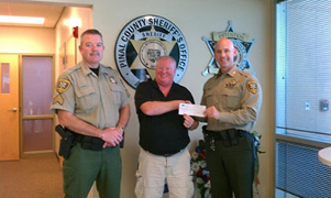 Sgt Jim Meadows, Larry Ramirez, Sheriff Paul Babeau MSM Community Schools Receives $2000 from PCSO.jpg